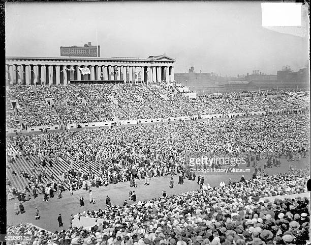 People walking along a wide pathway in Soldier Field during the International Eucharistic Congress Chicago Illinois 1926