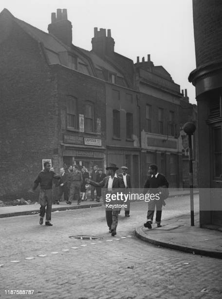 People walking along Cable Street in Stepney East London UK 13th November 1947