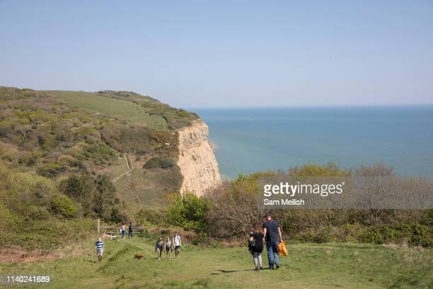 People walking along East Hill cliffs in the Hastings Country Park Nature Reserve on the 20th April 2019 in Hastings in the United Kingdom Hastings...