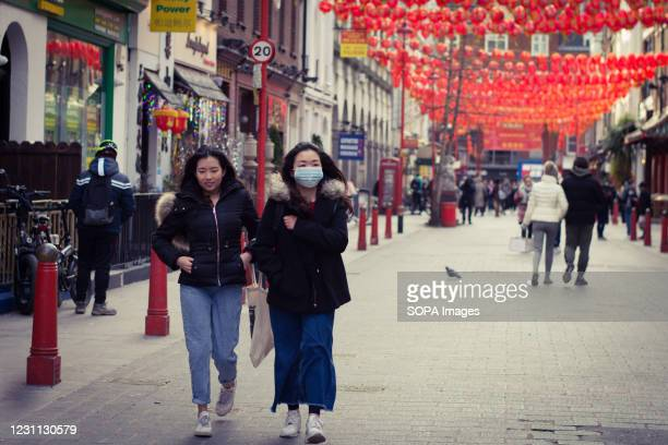 People walking along Gerrard Street during Chinese New year. The celebrations of the Chinese New Year 2021 begins with the new moon in London.