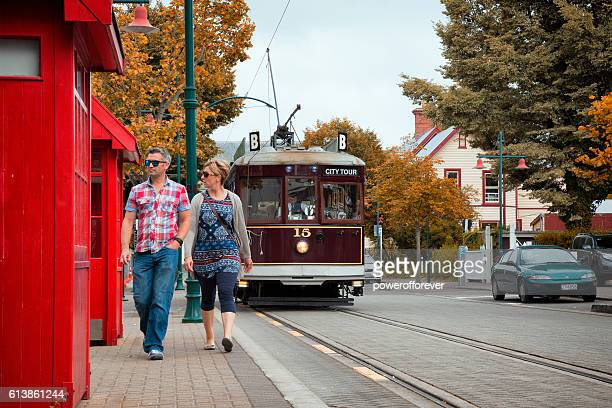 People walking along street with tram in Christchurch, New Zealand