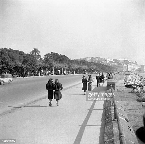 People walking along the Caracciolo promenade Naples 1949