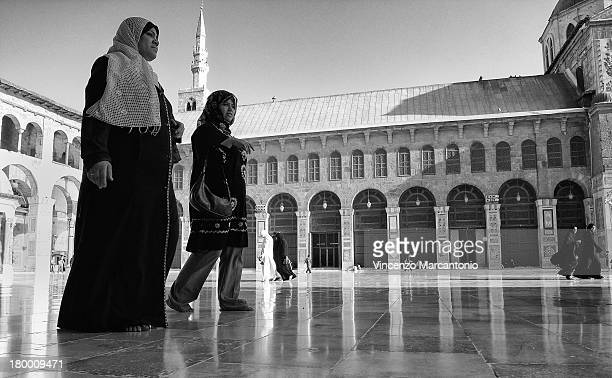 CONTENT] People walking along the Dome of the Treasury Umayyad Mosque of Damascus Syria Exif_JPEG_PICTURE