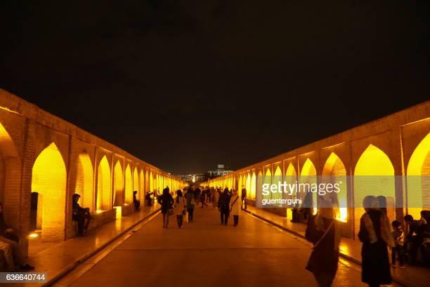 People walking along the Si-o-se Pol in Isfahan, Iran