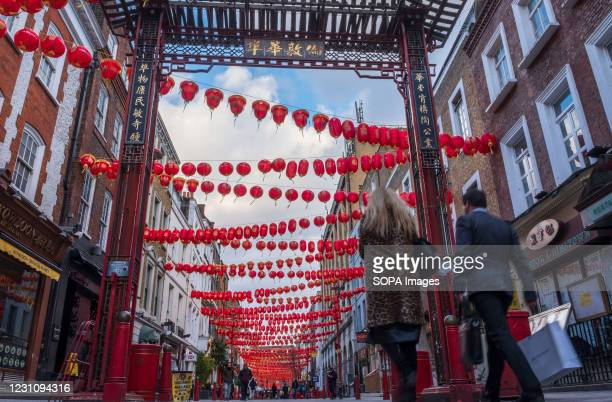 People walking along the Street of China Town in London. Chinese New Year is the biggest festival in Asia. Every year, hundreds of thousands of...