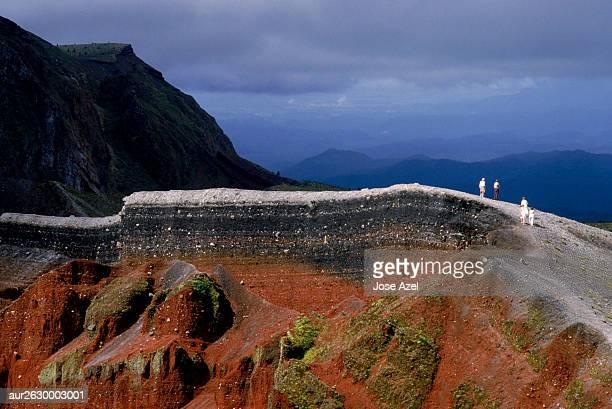 people walking along volcano rim, mount tarawera, new zealand.. - travel14 stock pictures, royalty-free photos & images