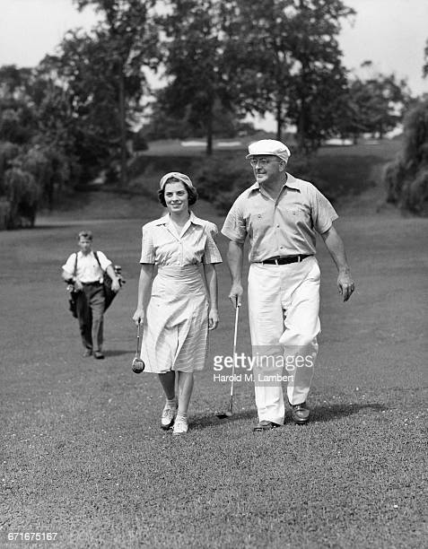 people walking and holding golf club  - {{relatedsearchurl(carousel.phrase)}} stock pictures, royalty-free photos & images