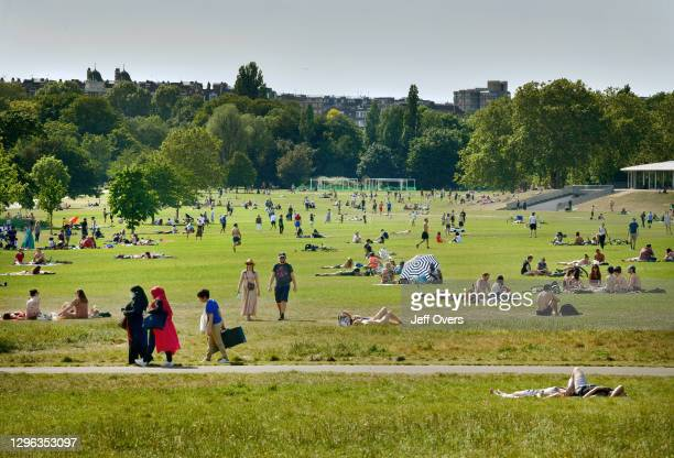 People walking and relaxing in Regents Park on a warm, sunny Bank holiday Monday during the Lockdown, London, 25th May, 2020.