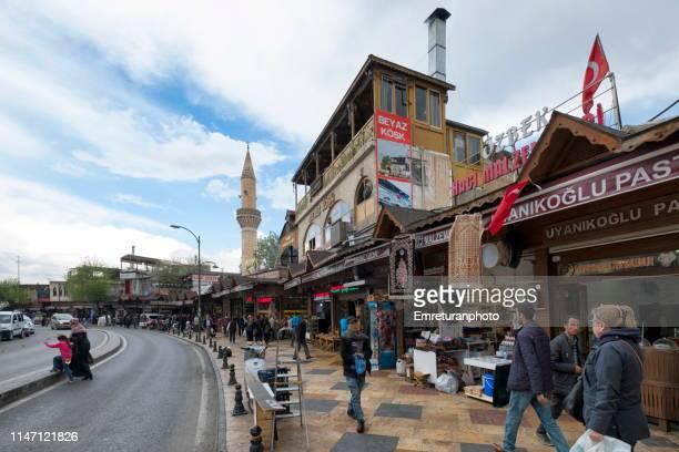 people walking and shopping at balikligöl street in şanlıurfa. - emreturanphoto stock pictures, royalty-free photos & images