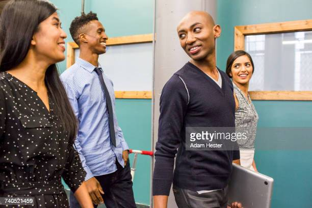 people walking and smiling indoors - black transgender stock pictures, royalty-free photos & images