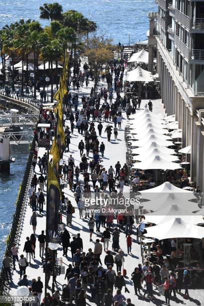 People walking around Circular Quay in the warm winter sunshine on August 5 2018 in Sydney Australia Sydney has had 13 days of at least 20 degrees in...