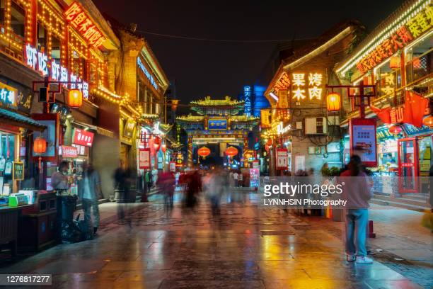 people walking around in the food street(hat alley) of taiyuan city - lynnhsin stock pictures, royalty-free photos & images