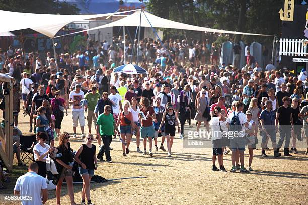 people walking around on roskilde festivalsquare - roskilde fjord stock pictures, royalty-free photos & images