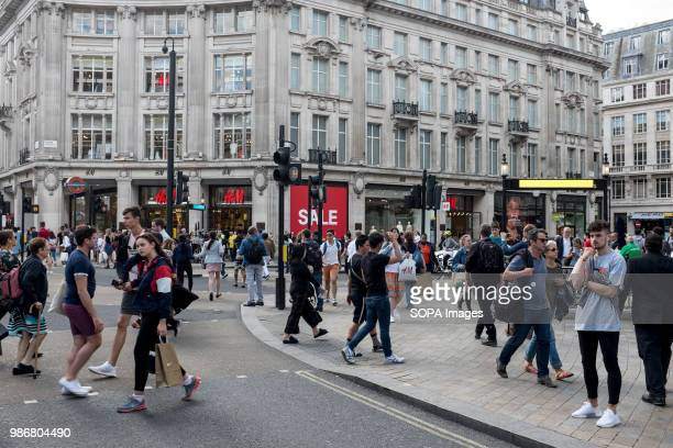 People walking around Oxford Station and street London is the Capital city of England and the United Kingdom it is located in the south east of the...