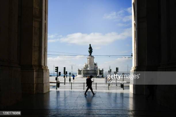 People walking around the Arco de Augusta and the Praca de Comercio in Baixa district, Lisbon. According to data provided by the General Health...