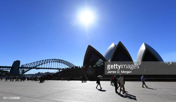 People walking around the forecourt of the Opera House in the warm winter sunshine on August 5 2018 in Sydney Australia Sydney has had 13 days of at...
