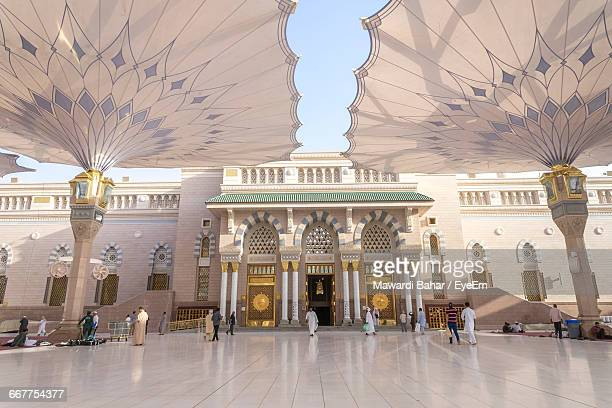 people walking at al-masjid an-nabawi - mosque stock pictures, royalty-free photos & images