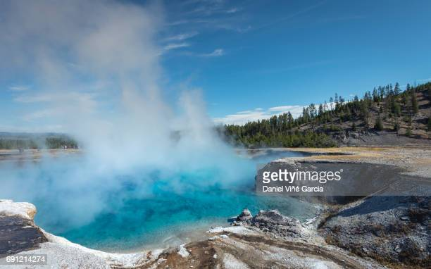 people walking at excelsior geyser crater, midway geyser basin, yellowstone state park. - hot spring stock pictures, royalty-free photos & images