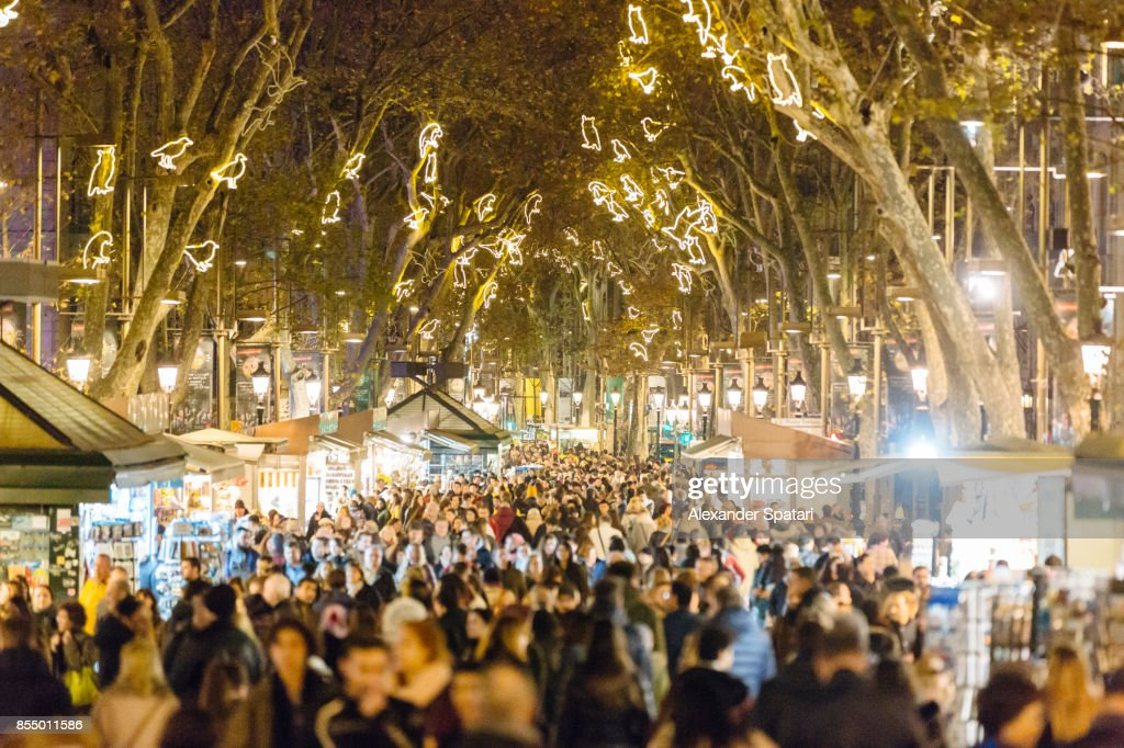 People walking at La Rambla street during Christmas and New Year holidays in Barcelona, Catalonia, Spain : Stock Photo