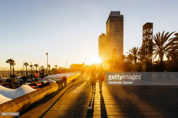 People walking at Passeig Maritim (Promenade) in Port Olimpic, Barcelona, Catalonia, Spain