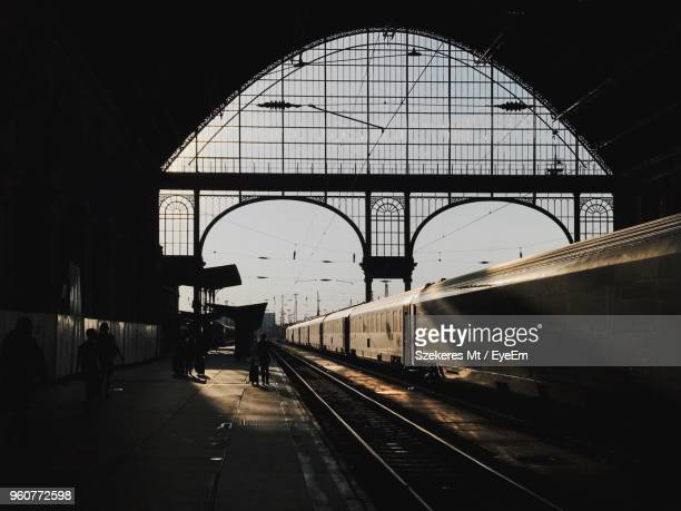 people walking at railroad station platform - keleti train station stock photos and pictures