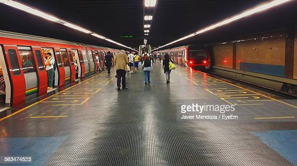 people walking at subway station platform - subway station stock pictures, royalty-free photos & images