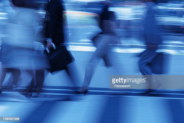 People walking at the crosswalk, side view, blurred motion, toned image, Tokyo, Japan