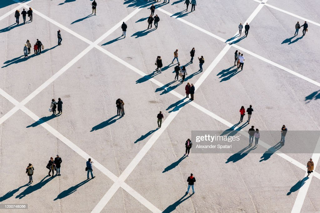 People walking at the town square on a sunny day : Stock Photo