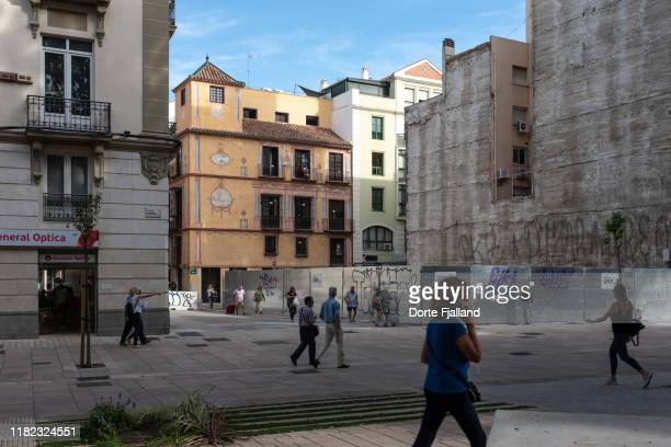 people walking back and forth on a sidewalk with buildings in the background - dorte fjalland stock pictures, royalty-free photos & images