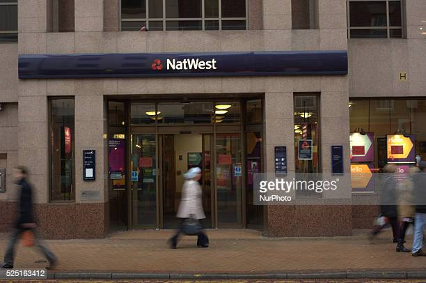 People walking by a branch of the Natwest Bank in Preston on November 27 2014