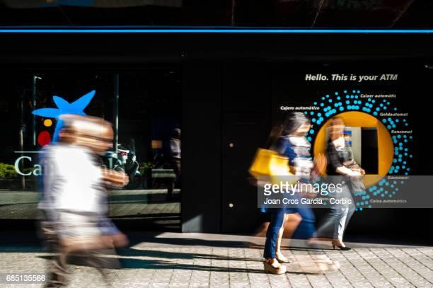 People walking by a Caixa Bank office on May 17 2017 in Barcelona Spain 'n'n