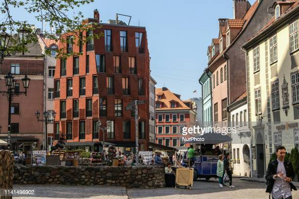 People walking by the old town street are seen in Riga Latvia on 28 April 2019