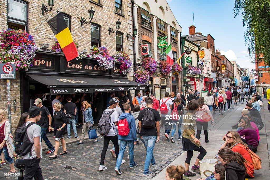 People walking down a busy street in Dublin : Stock Photo