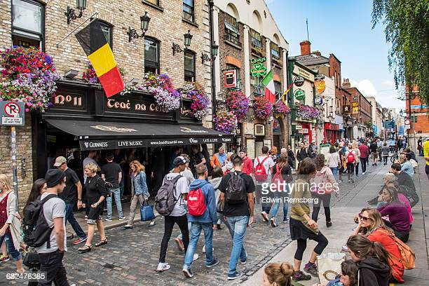 people walking down a busy street in dublin - dublin stock pictures, royalty-free photos & images