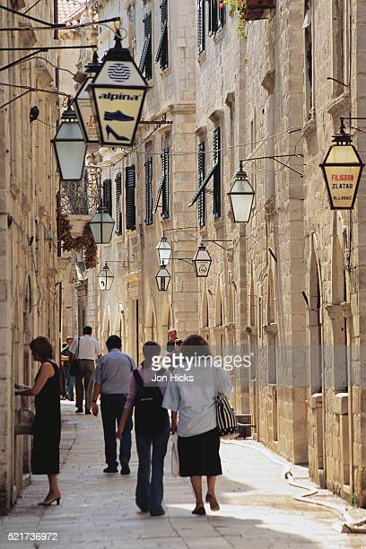 People Walking down a Dubrovnik Alley