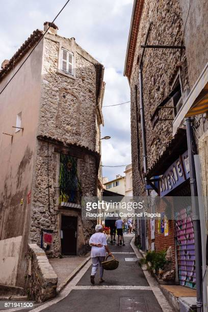 AZUR ALPESMARITIMES FRANCE People walking down a street passing by traditional houses