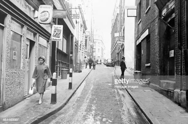 People walking down Botolph Lane City of London
