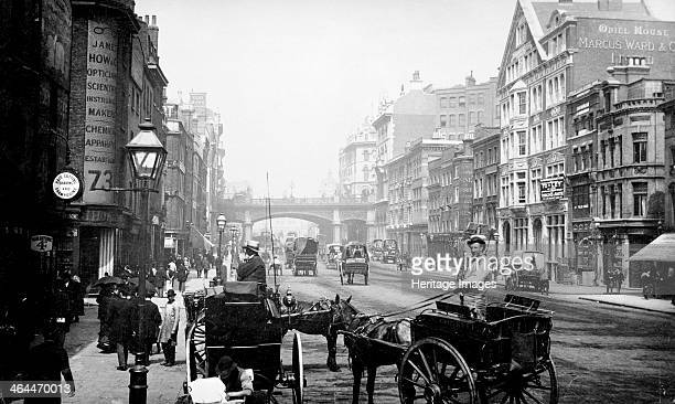 People walking down Farringdon Street looking towards Holborn Viaduct City of London 1890