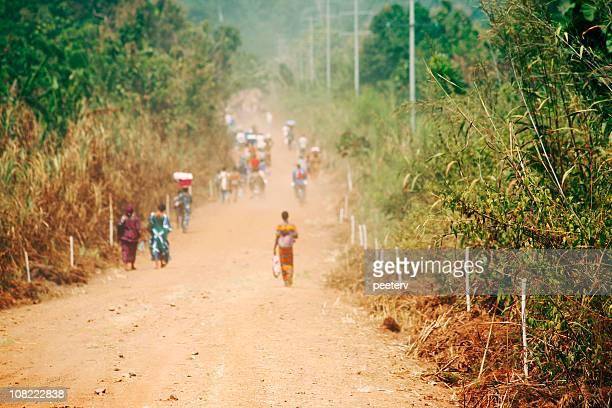 People Walking Down Road in Africa
