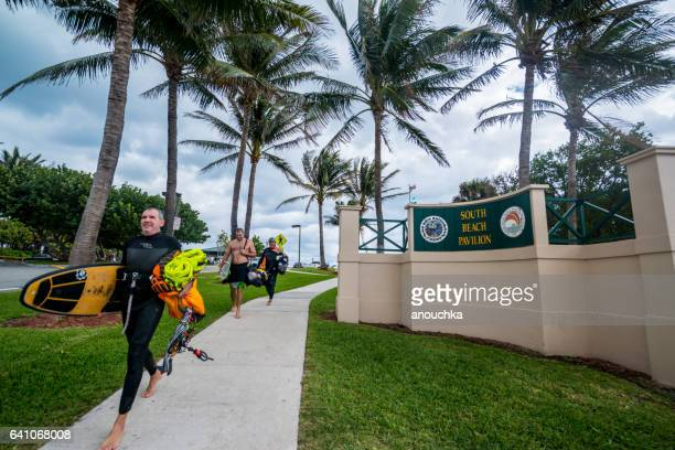 People walking from the beach before rain, Boca Raton, USA