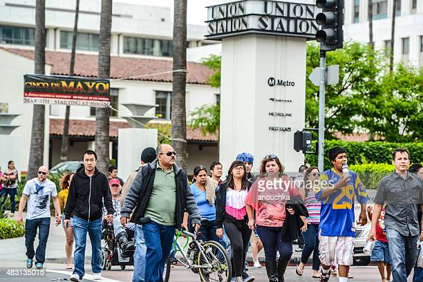 people walking from union station to cinco de mayo celebration - union station los angeles stock photos and pictures
