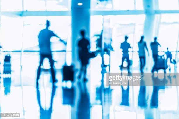 people walking in a busy airport