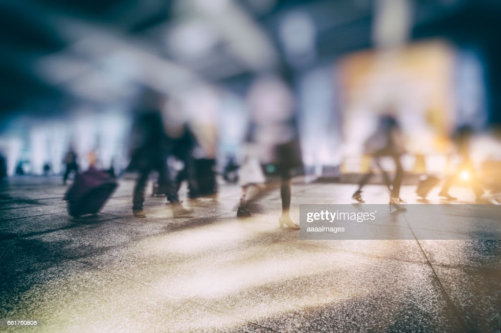 people walking in a busy airport : Stock Photo
