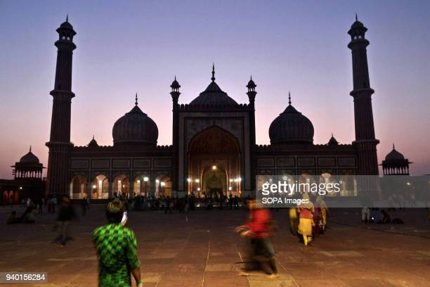 People walking in a courtyard of Jama Masjid or Grand Mosque in Old Delhi India Jamia Masjid or Grand Mosque is Asia's largest mosque Jamia Masjid...