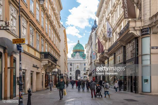 people walking in a pedestrian street at downtown vienna, austria. - vienna austria stock pictures, royalty-free photos & images