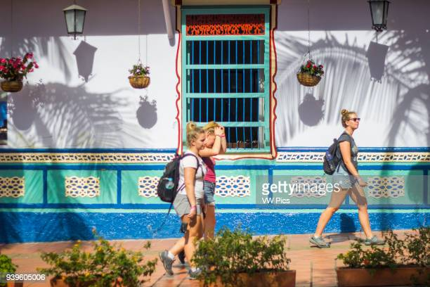 People walking in a sunny day in Guatape