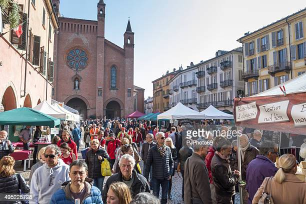 people walking in alba (italy) during truffle fair - piedmont italy stock pictures, royalty-free photos & images