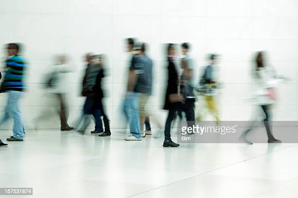 People walking in corridor, blurred motion