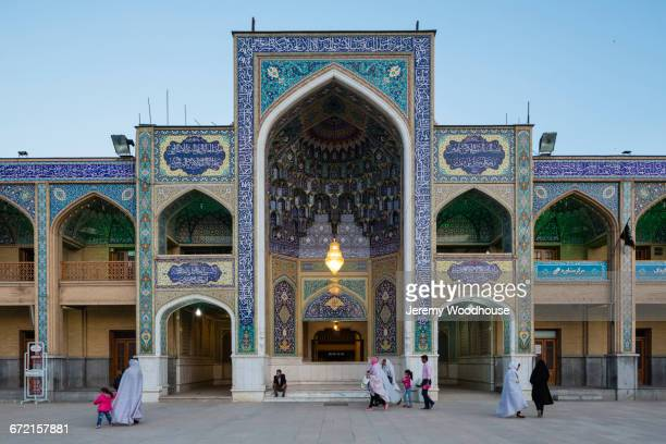 people walking in courtyard, shiraz, iran - shiraz stock pictures, royalty-free photos & images