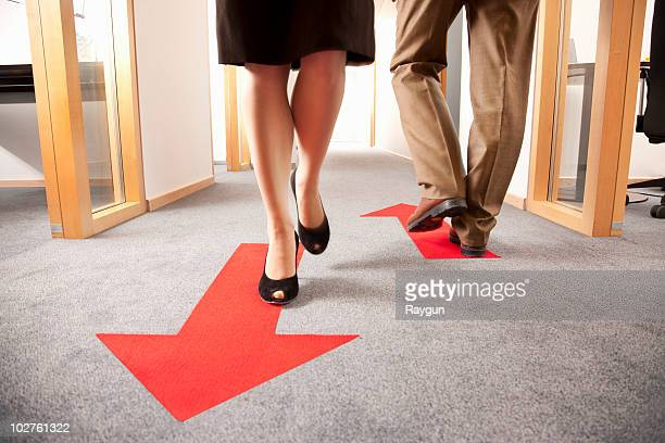 people walking in different directions - following arrows stock pictures, royalty-free photos & images